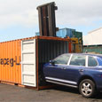 Loading car into container for export